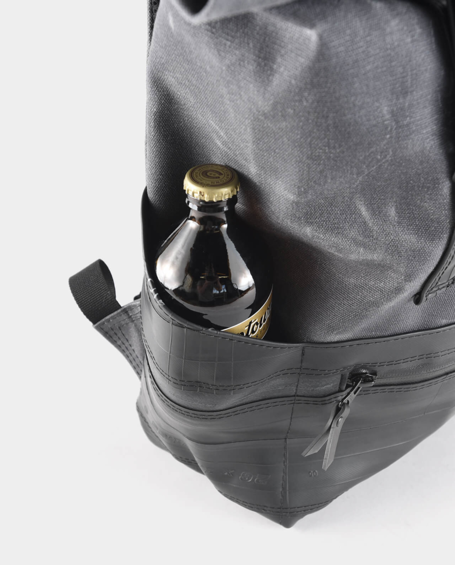 waxed canvas roll top backpack with recycled bike inner tubes
